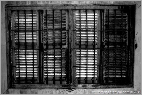 Tuol Sleng prison window in black and white