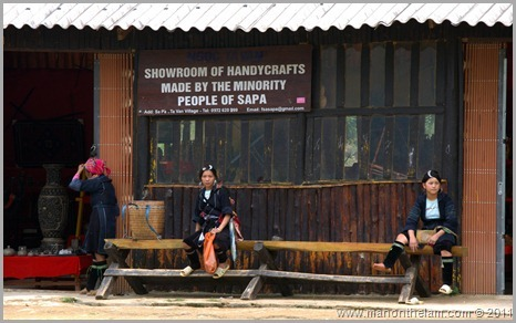 Vietnamese hill tribe women outside handicraft store, Sapa, Vietnam