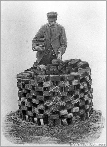 man cutting peat moss