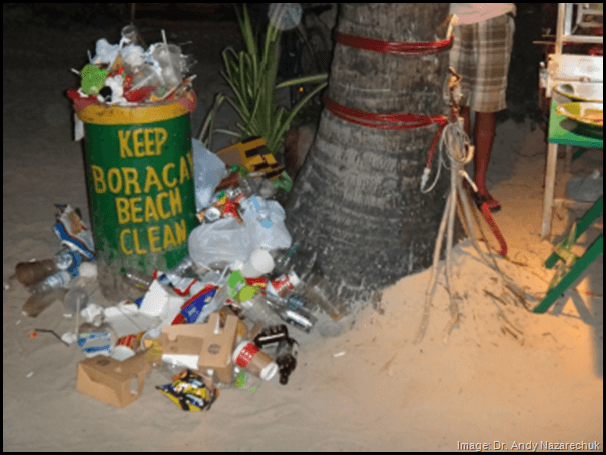 overflowing garbage can on the beach in Boracay Philippines