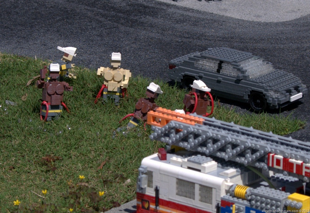 Beefy-shirtless-Firemen-in-a-field-Legoland-Florida-Aeroplan-Welcome-Aboard-Event.jpg