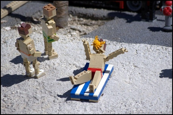 lego beach, lego men on beach, Killer crab attacking man on beach, closeup photo, minifigure, Miniland USA, Legoland Florida,