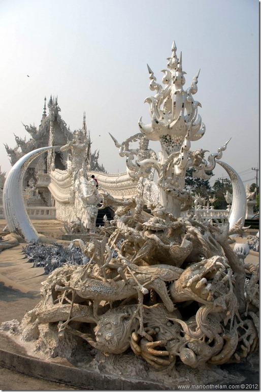 Sculpture of skulls -- Wat Rong Khun, White Temple, Chiang Rai, Thailand