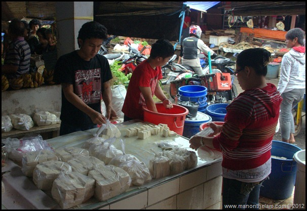 Making and packing tofu -- Tomohon Traditional Market, Tomohon, North Sulawesi, Indonesia 12