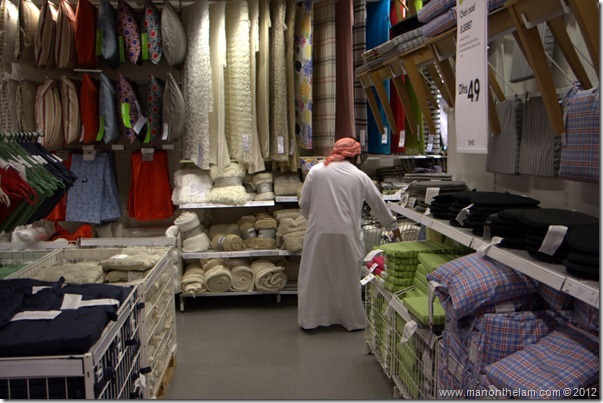 Arabic man shopping for carpets, Dubai IKEA, shopping in Dubai, UAE