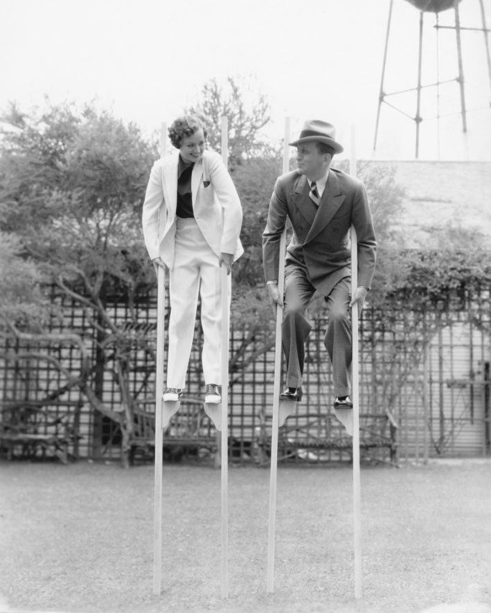 vintage couple on stilts -- go outside and exercise in the yard
